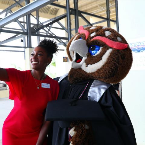 woman with FAU mascot